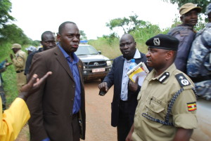 Kilak County MP Olanya Gilbert (left), Christopher Lakony (middle) face off with the northern regional police commander Paul Nkore (right) in Apaa last Monday. Photo by Sam Lawino