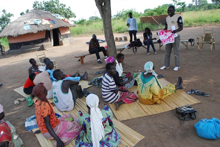 Community activists Stephen Oloya, having alight moment with residents of Wipolo Village in Palaro Sub County. PHOTOS BY CISSY MAKUMBI