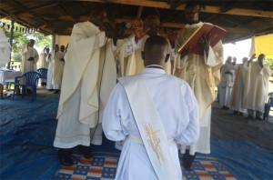 Father Mathew Orach Ssemwanga being blessed by Archbishop John Bapist Odama during his ordination. Photo by David Livingstone Okumu