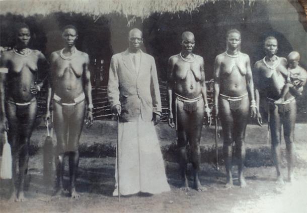 Puranga chief Rwot Andrea Olal Adiri and his wives dressed in Cenu, acholi traditional wears