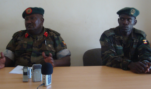 Col. Kulaigye (left) flanked by the 4th Division Army PRO Lt. Isaac Oware (Right).