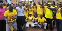 Kalang memmbers dressed in NRM shirt pose with Santa Oketta special presidential assistance Northern Uganda