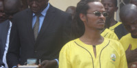 Rasta Guwan, behind him is Gulu RDC Andrew Awany