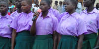 Girls sing during the African Child Day commemoration in Gulu on Tuesday at Bobi Sub County. Photo by James Owich