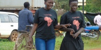 Ketty Adoch, 17, a Nodding Syndrome sufferer (L) having light moment with Christine Apio (R), the Communications Officer for Hope for Humans, a local NGO supporting children affected by Nodding Syndrome on Tuesday in Gulu. Photo by James Owich