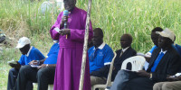 The retired Anglican Bishop for Northern Uganda Diocese Nelson Onono Onweng addresses 2004 LRA survivors during International Criminal Justice day at Lukodi on Friday last week