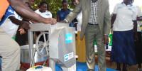 Gulu District LCV Chairman Martin Ojara Mapenduzi testing the cassava chipper machine donated to farmers' group in Lapeta village, Unyama Sub County in Gulu district recently. Photo by James Owich
