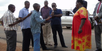 Gabindadde Musoke (in blue t-shirt and dark shades, the Permanent Secretary, Ministry of Lands, Housing and Urban Development accompanied by Gulu Municipal Council and CHICO officials touring road projects funded by World Bank in Gulu Municipality on Tuesday