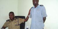 Mr Okoshi (left) parades the suspect at Nwoya Police station in Anaka