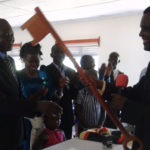 New Lamwo LC5 chairman Komakech John Ogwok receives the key symbol from Kitgum chief magistrate, Okongo Japyem, shortly after being sworn in on Monday at the district council hall.