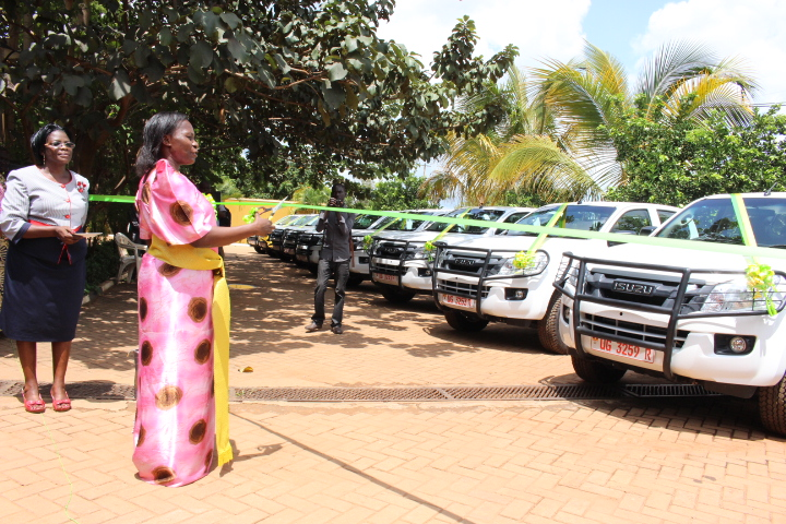 state-minister-for-local-government-ms-jennifer-namuyangu-cuts-a-tape-to-hand-over-11-double-cabin-pickup-vehicles-to-distruct-heads-within-acholi-and-adjumani-district-photo-by-denis-otim